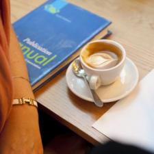 APA Publishing Manual and coffee